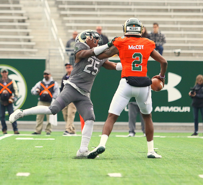 Colorado State cornerback Darius Campbell gets credit for a sack of Justice McCoy during Saturday's Green-Gold game at CSU Stadium. The defense wrapped up spring camp with a 44-31 win. (Javon Harris/For the Loveland Reporter-Herald)