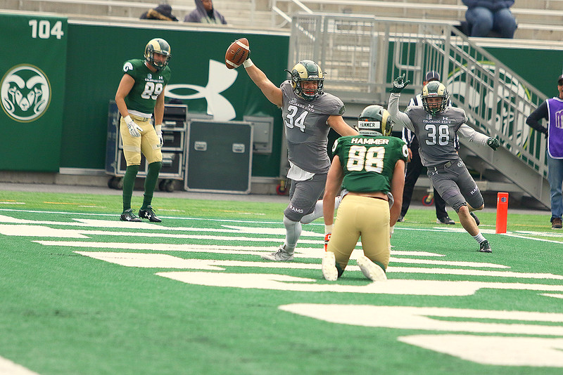 Colorado State linebacker Anthony Giusti celebrates his interception off a tipped pass during the red-zone portion of Saturday's Green-Gold game at CSU Stadium. The defense came away with a 44-31 victory. (Javon Harris/For the Loveland Reporter-Herald)