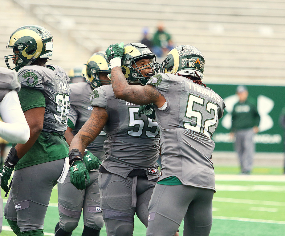 Colorado State linebackers Tre Thomas (52) and Josh Watson celebrate a defensive stop in Saturday's Green-Gold game at CSU Stadium. The defense won the contest 44-31 under an altered scoring system. (Javon Harris/For the Loveland Reporter-Herald)