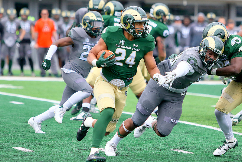 Colorado State running back Izzy Matthews heads for the corner during Saturday's Green-Gold game at CSU Stadium. Matthews had a strong day running the ball, scoring the first touchdown on a 2-yard run. (Javon Harris/For the Loveland Reporter-Herald)