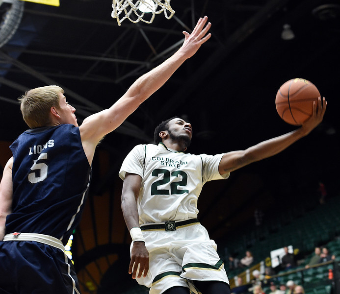 Colorado State University's #22 J.D. Paige goes up for a shot as Arkansas-Fort Smith's #5 Brett Jolly tries to block during their game Tuesday, Dec. 6, 2016, at Moby Arena in Fort Collins. (Photo by Jenny Sparks/Loveland Reporter-Herald)