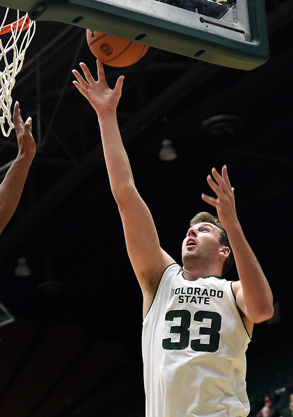 Colorado State University's #33 Braden Koelliker goes up for a shot  during their game against Arkansas-Fort Smith Tuesday, Dec. 6, 2016, at Moby Arena in Fort Collins. (Photo by Jenny Sparks/Loveland Reporter-Herald)