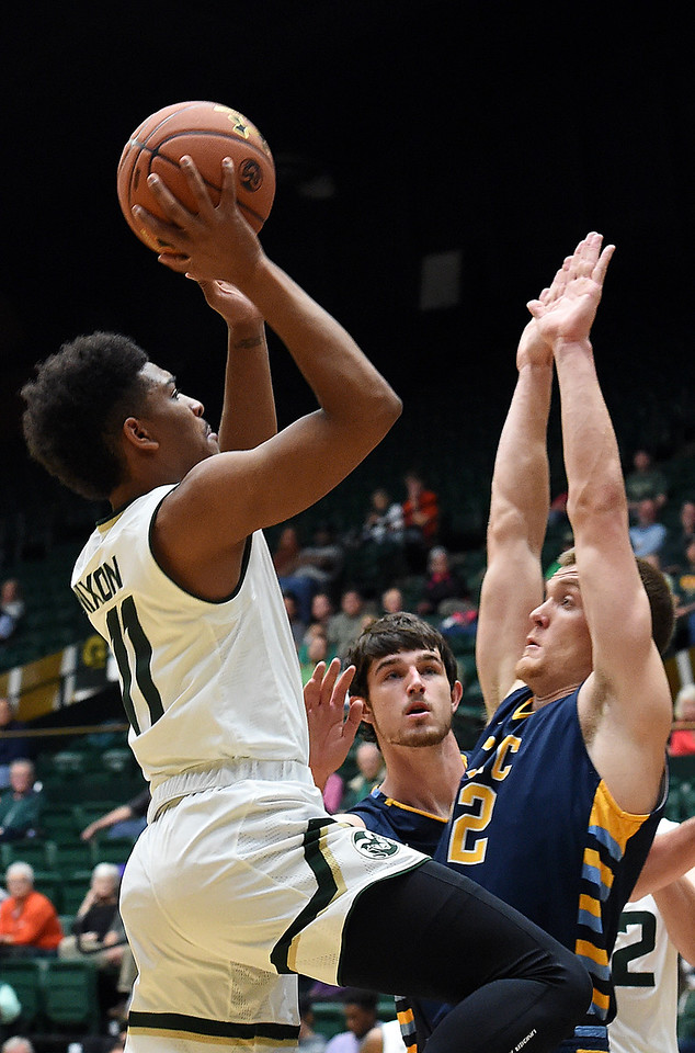 Colorado State University's #11 Prentiss Nixon goes up for a shot as Fort Lewis' #12 Rasmus Bach tries to block during their game Wednesday, Nov. 16, 2016, at Moby Arena in Fort Collins. (Photo by Jenny Sparks/Loveland Reporter-Herald)