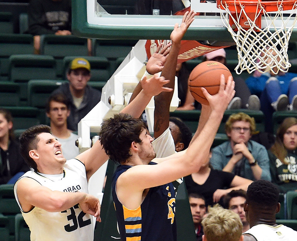 Colorado State University's #32 Nico Carvacho Braden blocks Fort Lewis' #42 Riley Farris during their game Wednesday, Nov. 16, 2016, at Moby Arena in Fort Collins. (Photo by Jenny Sparks/Loveland Reporter-Herald)