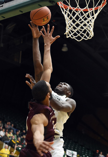 Colorado State University's #2 Emmanuel Omogbo shoots as Maryland Eastern Shore's #24 Derrico Peck tries to block during their game Wednesday, Nov. 23, 2016, at Moby Arena in Fort Collins. (Photo by Jenny Sparks/Loveland Reporter-Herald)