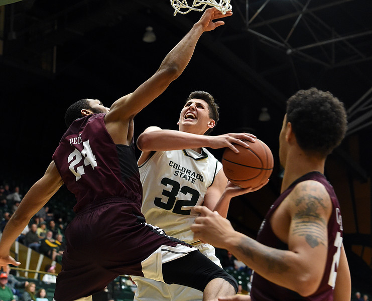 Colorado State University's #32 Nico Carvacho foes up for a shot as Maryland Eastern Shore's #24 Derrico Peck and #20 Dontae Caldwell try to block during their game Wednesday, Nov. 23, 2016, at Moby Arena in Fort Collins. (Photo by Jenny Sparks/Loveland Reporter-Herald)