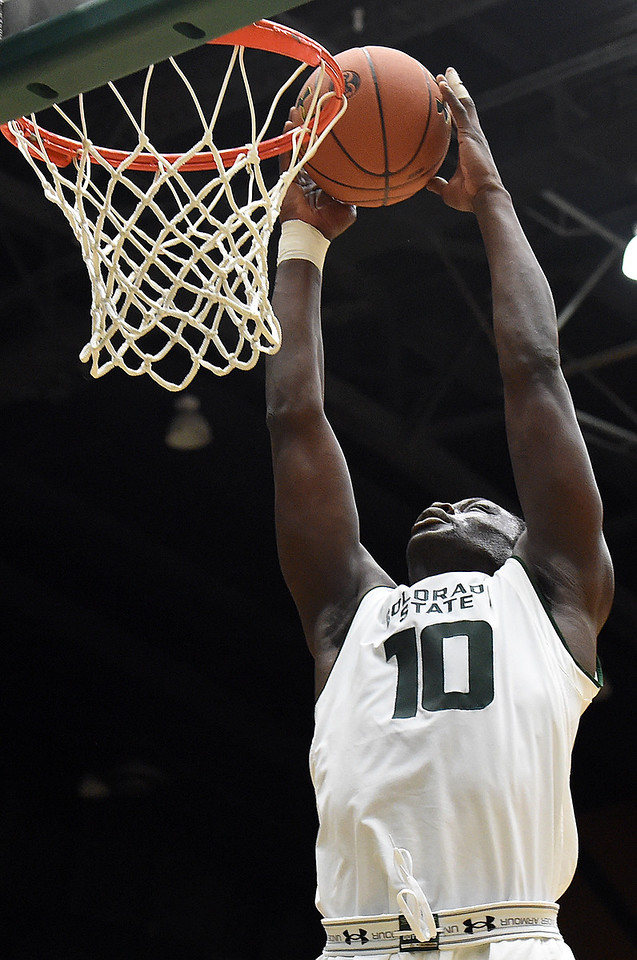 Colorado State University's #10 Che Bob dunks the ball during their game against Maryland Eastern Shore Wednesday, Nov. 23, 2016, at Moby Arena in Fort Collins. (Photo by Jenny Sparks/Loveland Reporter-Herald)