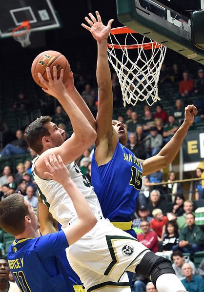 Colorado State University's #33 Braden Koelliker goes up for a shot as San Jose State's #11 E.J. Boyce and #15 Brandon Clarke try to block during their game on Wednesday, Jan. 25, 2017, at Moby Arena in Fort Collins. (photo by Jenny Sparks/Loveland Reporter-Herald)