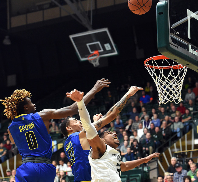 Colorado State University's #3 Gian Clavell goes up for a rebound along with San Jose State's #0 Terrell Brown and #21 Jalen James during their game on Wednesday, Jan. 25, 2017, at Moby Arena in Fort Collins. (photo by Jenny Sparks/Loveland Reporter-Herald)
