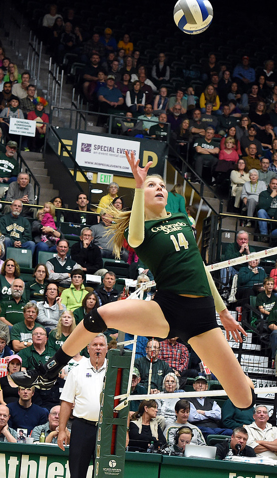 Colorado State University's #14 Alexandra Poletto jumps up to tip the ball during their game against Wyoming on Tuesday, Nov. 22, 2016, at Moby Arena in Fort Collins. (Photo by Jenny Sparks/Loveland Repdorter-Herald)