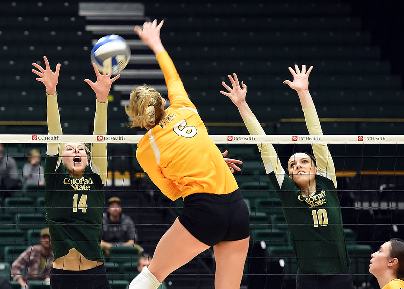 Colorado State University's #14 Alexandra Poletto, left, and #10 Sanja Cizmic block a shot by Wyoming's #6 Laura Beach during their game on Tuesday, Nov. 22, 2016, at Moby Arena in Fort Collins. (Photo by Jenny Sparks/Loveland Repdorter-Herald)
