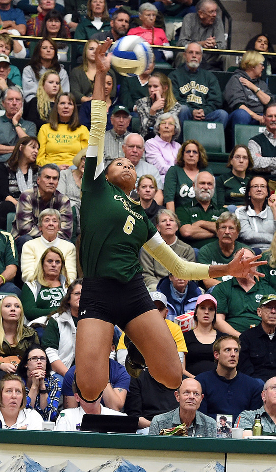Colorado State University's #6 Jasmine Hanna spikes the ball during their game against Wyoming on Tuesday, Nov. 22, 2016, at Moby Arena in Fort Collins. (Photo by Jenny Sparks/Loveland Repdorter-Herald)