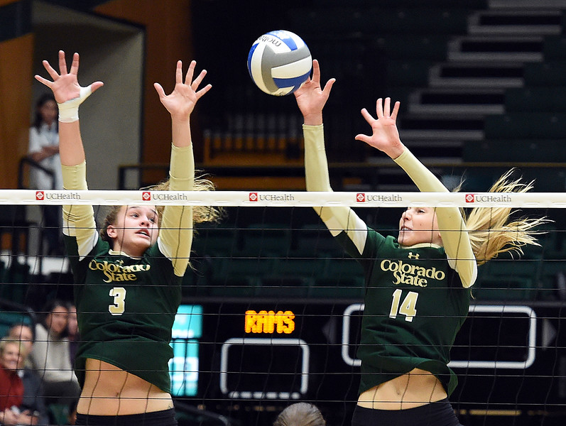 Colorado State University's #3 Olivia Nicholson, left, and #14 Alexandra Poletto block the ball during their game against Wyoming on Tuesday, Nov. 22, 2016, at Moby Arena in Fort Collins. (Photo by Jenny Sparks/Loveland Repdorter-Herald)
