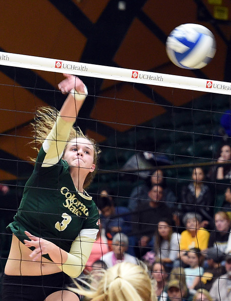 Colorado State University's #3 Olivia Nicholson spikes the ball during their game against Wyoming on Tuesday, Nov. 22, 2016, at Moby Arena in Fort Collins. (Photo by Jenny Sparks/Loveland Repdorter-Herald)