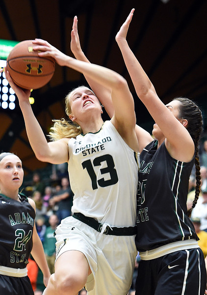 Colorado State University's #13 Ellen Nystrom is blocked by Adams State #20 Madison Merschel during their game Wednesday, Nov. 23, 2016, at Moby Arena in Fort Collins. (Photo by Jenny Sparks/Loveland Reporter-Herald)