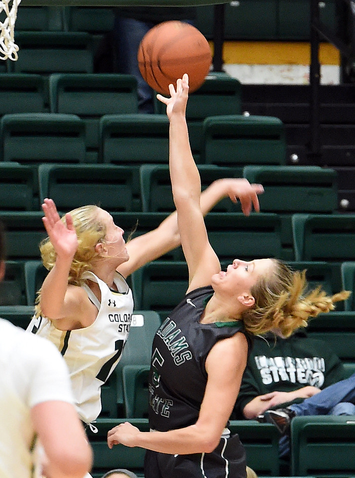Colorado State University's #13 Ellen Nystrom blocks a shot by Adams State's #5 Cydney McHenry during their game Wednesday, Nov. 23, 2016, at Moby Arena in Fort Collins. (Photo by Jenny Sparks/Loveland Reporter-Herald)