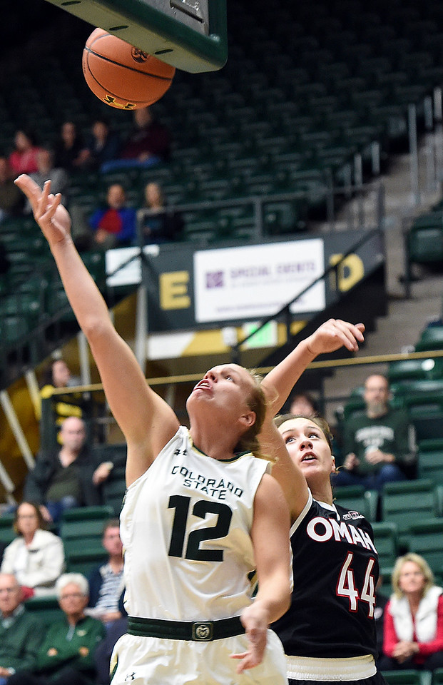 Colorado State University's #12 Callie Kaiser goes up for a shot as Omaha'S #44 Michaela Dapprich tries to block during their game Friday, Nov. 11, 2016, at Moby Arena in Fort Collins.   (Photo by Jenny Sparks/Loveland Reporter-Herald)