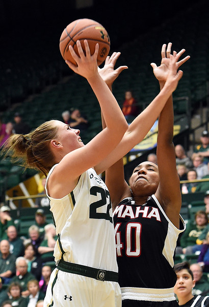 Colorado State University's #22 Elin Gustavsson goes up for a shot as Omaha'S #40 Jay Bridgeman tries to block during their game Friday, Nov. 11, 2016, at Moby Arena in Fort Collins.   (Photo by Jenny Sparks/Loveland Reporter-Herald)