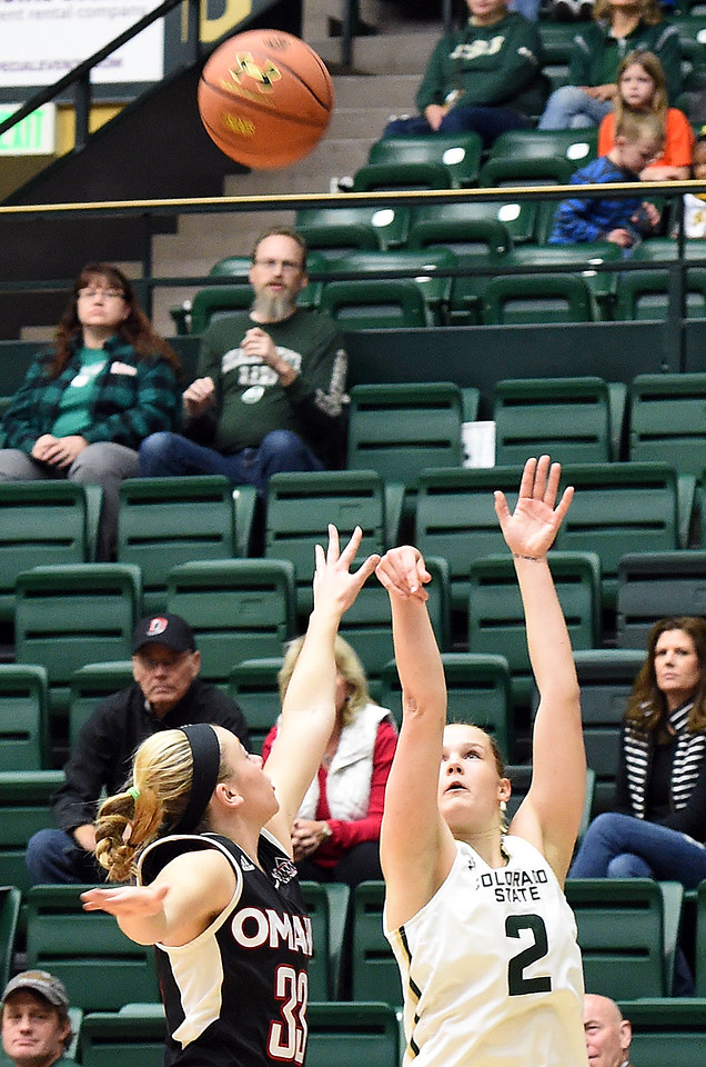 Colorado State University's #2 Stine Austgulen goes up for a shot as Omaha's #33 Remy Davenport tries to block during their game Friday, Nov. 11, 2016, at Moby Arena in Fort Collins.   (Photo by Jenny Sparks/Loveland Reporter-Herald)
