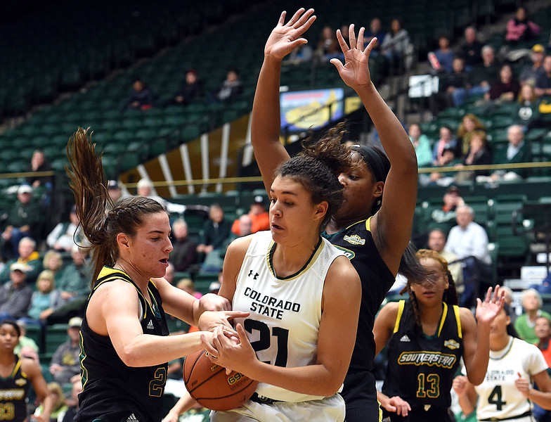 Colorado State University's #21 Myanne Hamm and Southeastern Louisiana's #23 Jaclyn Scholvin try to get control of the ball during their game Friday, Dec. 3, 2016, at Moby Arena in Fort Collins. (Photo by Jenny Sparks/Loveland Reporter-Herald)