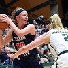 Fresno State's #30 Kristina Cavey looks to pass as Colorado State's #2 Stine Austgulen tries to block during their game Wednesday, Jan. 18, 2017, at Moby Arena in Fort Collins. Cavey is from Berthoud. (Photo by Jenny Sparks/Loveland Reporter-Herald)
