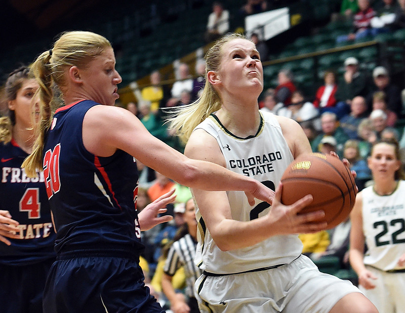 Colorado State's #2 Stine Austgulen goes up for a shot past Fresno's #Emilie Volk during their game Wednesday, Jan. 18, 2017, at Moby Arena in Fort Collins. (Photo by Jenny Sparks/Loveland Reporter-Herald)