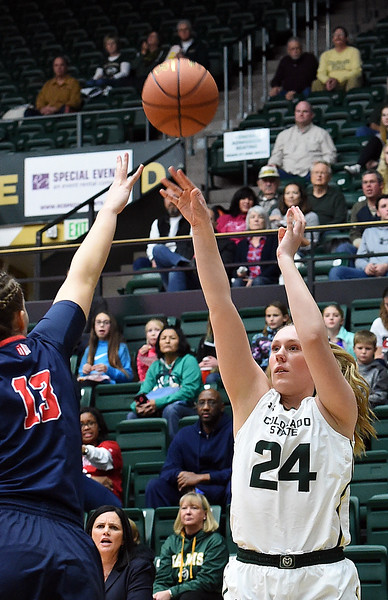 Colorado State's #24 Amanda Kantzy shoots as Fresno's #13 Anais Kirvan tries to block during their game Wednesday, Jan. 18, 2017, at Moby Arena in Fort Collins. (Photo by Jenny Sparks/Loveland Reporter-Herald)