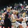 Colorado State's #13 Ellen Nystrom goes up for a shot past Fresno's #20 Emilie Volk during their game Wednesday, Jan. 18, 2017, at Moby Arena in Fort Collins. (Photo by Jenny Sparks/Loveland Reporter-Herald)