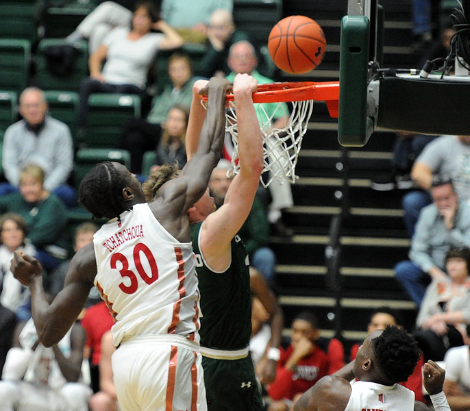 Tchamwa Tchatchou of UNLV blocks Adam Thistlewood on his dunk attempt during the Rams' 65-60 loss on Saturday. (Colin Barnard/Loveland Reporter-Herald)