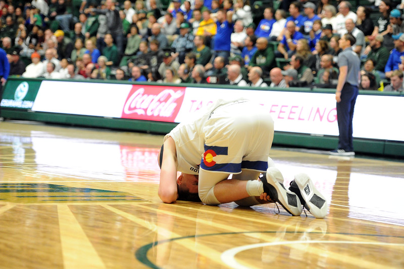 Nico Carvacho goes down with an ankle injury in the first half against Nevada on Feb. 6, 2019. (Colin Barnard/Loveland Reporter-Herald)