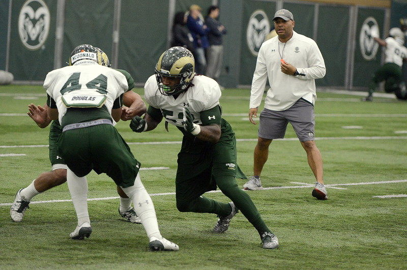 Colorado State senior linebacker Tre Thomas (52) works on blocking during a special team drill at Friday's practice. Head coach Mike Bobo said he has seen Thomas make more plays during spring camp. (Mike Brohard/Loveland Reporter-Herald).