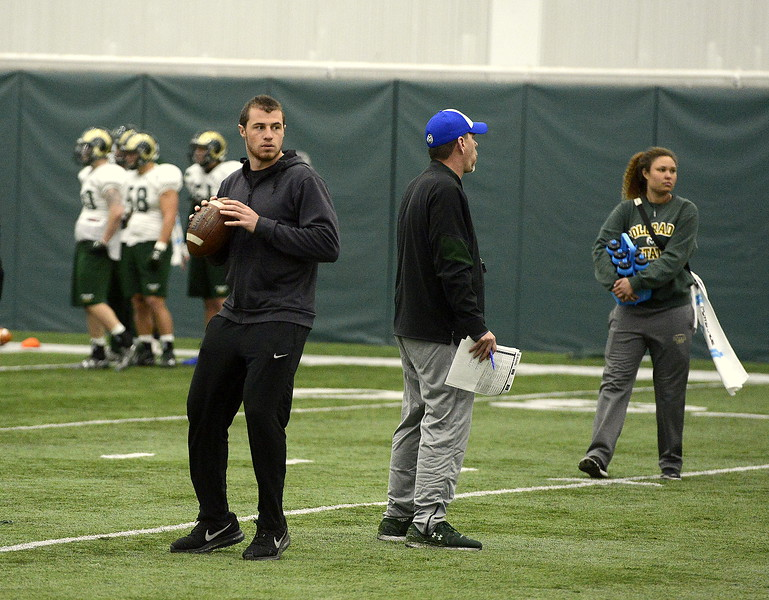 K.J. Carta-Samuels takes in some mental reps as he visits Colorado State's practice Friday. Carta-Samuels will join the program in the summer as a graduate transfer out of Washington. (Mike Brohard/Loveland Reporter-Herald).