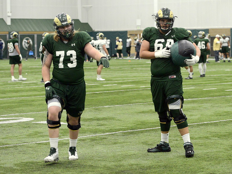 Colorado State offensive lineman Barry Wesley (69), a freshman walk-on from Bear Creek High School, has moved his way into the first group at left tackle, with Tyler Bjorklund (73) moving to right guard as the Rams use spring camp to rebuild an offensive front that loses three starters. (Mike Brohard/Loveland Reporter-Herald).