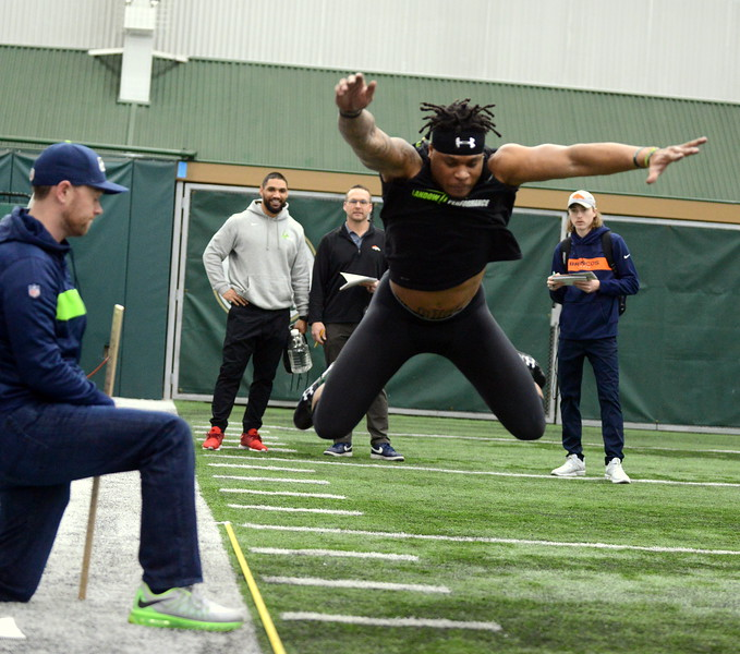 Josh Watson surges to 10 feet, 10 inches in the standing(Mike Brohard/Loveland Reporter-Herald) broad jump during Wednesday's pro-day testing in Colorado State's indoor practice facility.