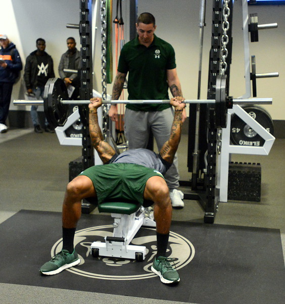 Colorado State linebacker Tre Thomas is spotted by strength and conditioning coach Joey Guarascio during pro-day testing at Canvas Stadium on Wednesday. Thomas recorded 25 reps. (Mike Brohard/Loveland Reporter-Herald)