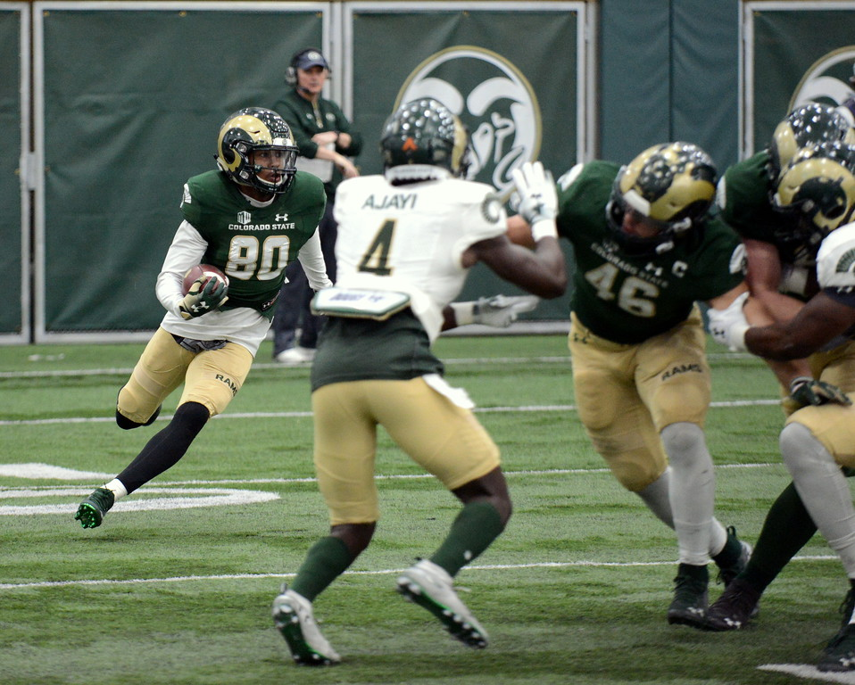 . Colorado State receiver Nikko Hall cuts behind his blockers after catching a quick pass during Thursday\'s scimmage at the indoor practice facility. (Mike Brohard/Loveland Reporter-Herald)