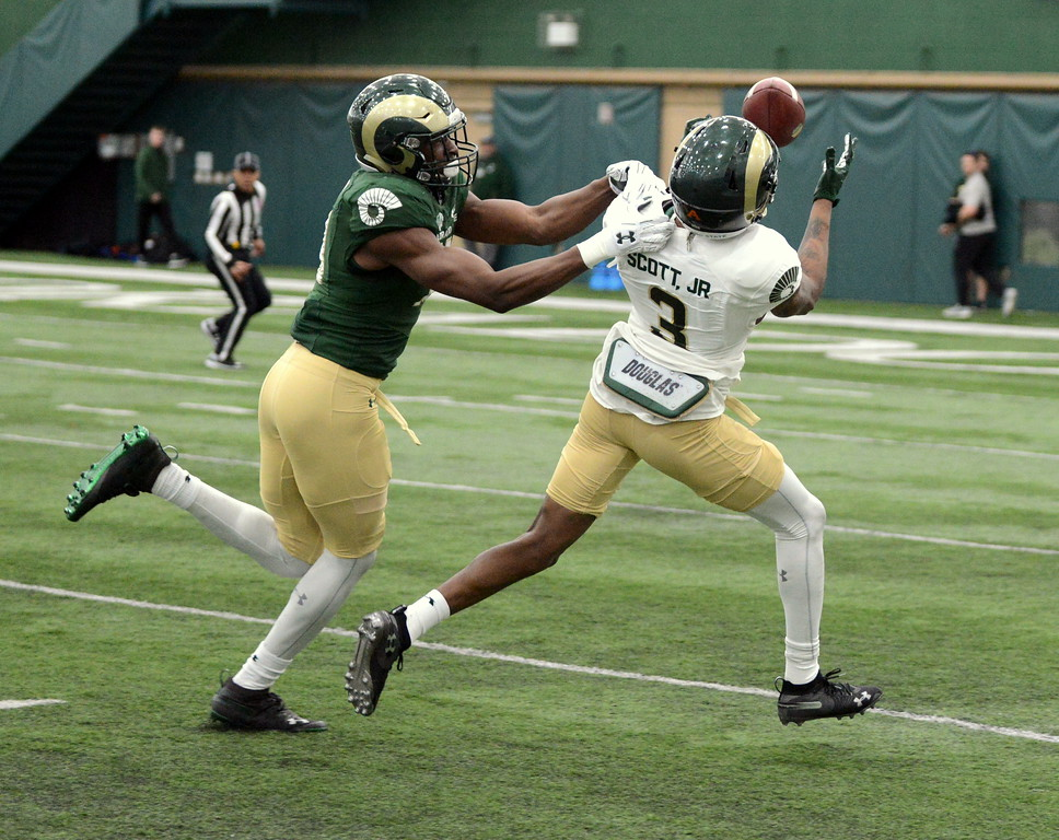 . Colorado State cornerback Braylin Scott breaks up a pass intended for E.J. Scott during Thursday\'s scimmage at the indoor practice facility. (Mike Brohard/Loveland Reporter-Herald)