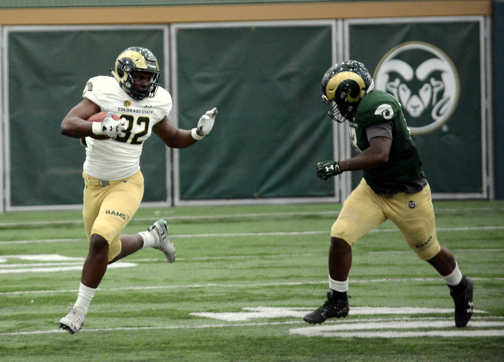 . Colorado State tight end Isiah Panunnzio braces for contact from linebacker Trey Sutton during Thursday\'s scimmage at the indoor practice facility. (Mike Brohard/Loveland Reporter-Herald)