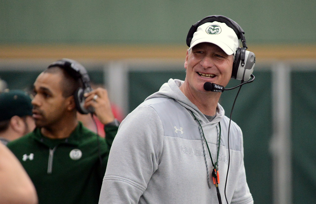 . Colorado State defensive coordinator John Jancek cracks a smile after a good defensive series during Thursday\'s scimmage at the indoor practice facility. (Mike Brohard/Loveland Reporter-Herald)