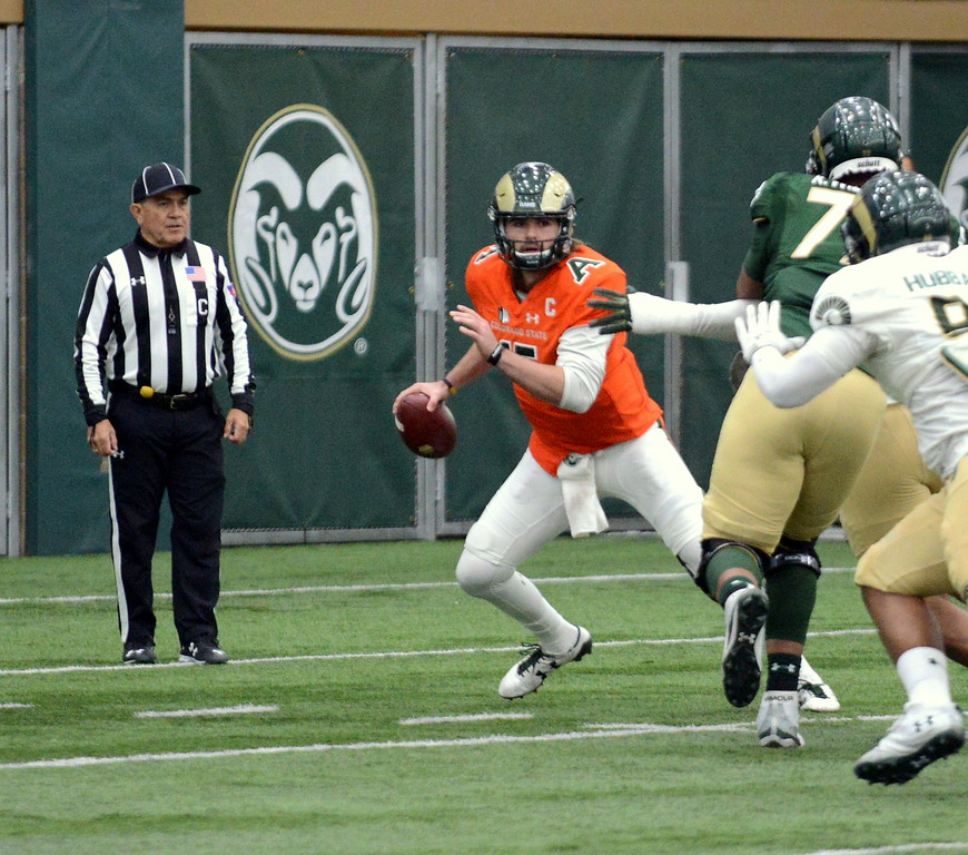 . Colorado State quarterback Collin Hill breaks out of the pocket during Thursday\'s scimmage at the indoor practice facility. (Mike Brohard/Loveland Reporter-Herald)