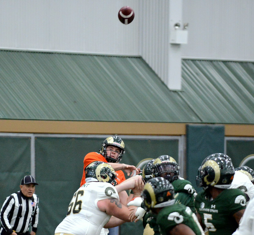 . Colorado State quarterback Patrick O\'Brien throws a deep pass during Thursday\'s scimmage at the indoor practice facility. (Mike Brohard/Loveland Reporter-Herald)