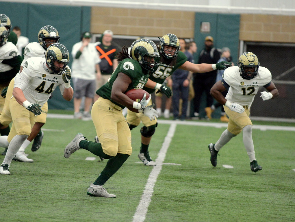 . Colorado State running back Marcus McElroy breaks off a big run in Thursday\'s scrimmage at the indoor practice facility to end spring camp for the Rams. McElroy had an impressive game as the Green beat the White, 24-16. (Mike Brohard/Loveland Reporter-Herald)