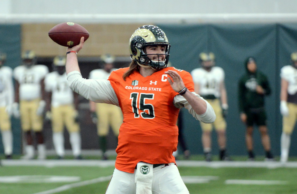 . Colorado State quarterback Collin Hill sets to unleash a touchdown pass to Warren Jackson during Thursday\'s scimmage at the indoor practice facility. (Mike Brohard/Loveland Reporter-Herald)