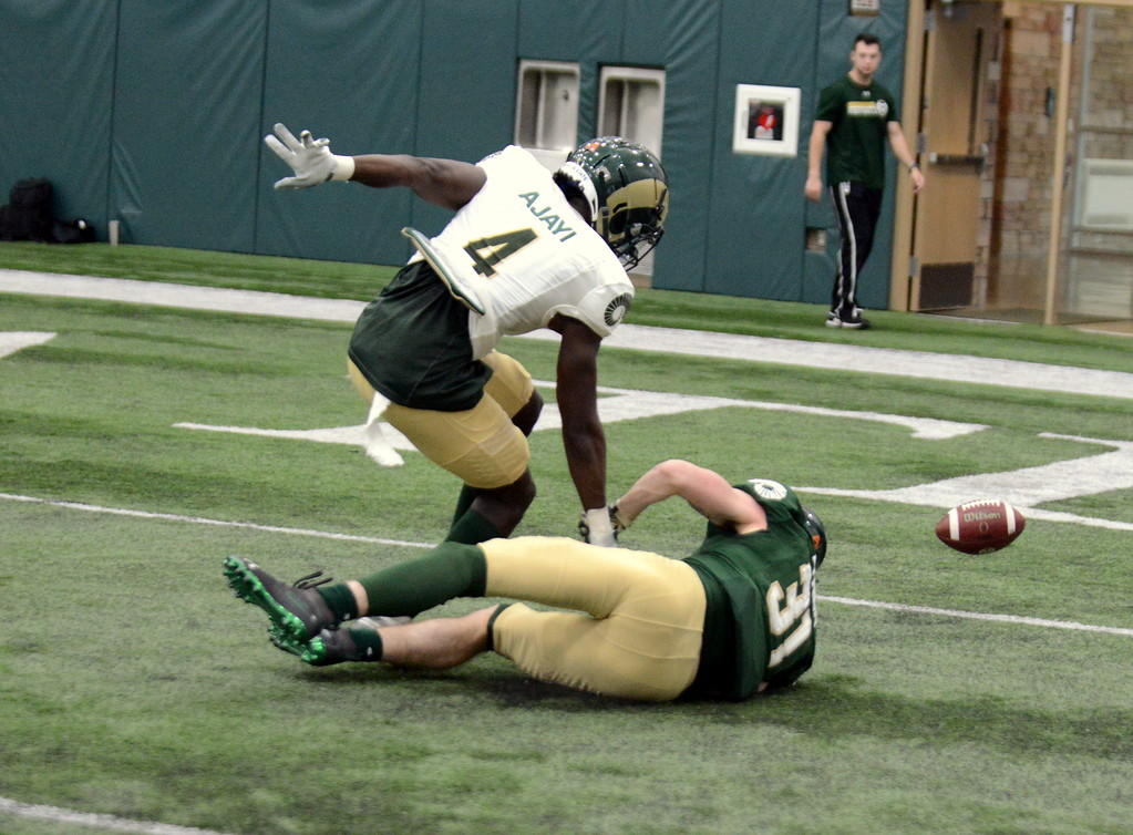 . Colorado State cornerback Rashad Ajayi breaks up a pass intended for Ryan Lynch during Thursday\'s scimmage at the indoor practice facility. (Mike Brohard/Loveland Reporter-Herald)