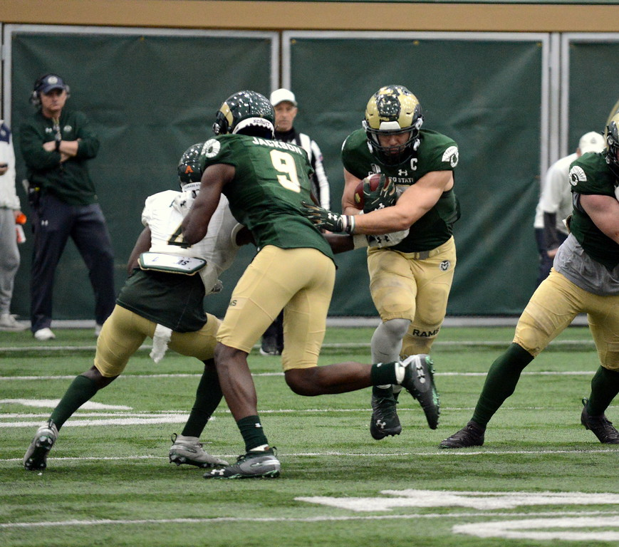 . Colorado State running back Adam Prentice cuts into the hole off the block of Warren Jackson during Thursday\'s scimmage at the indoor practice facility. (Mike Brohard/Loveland Reporter-Herald)