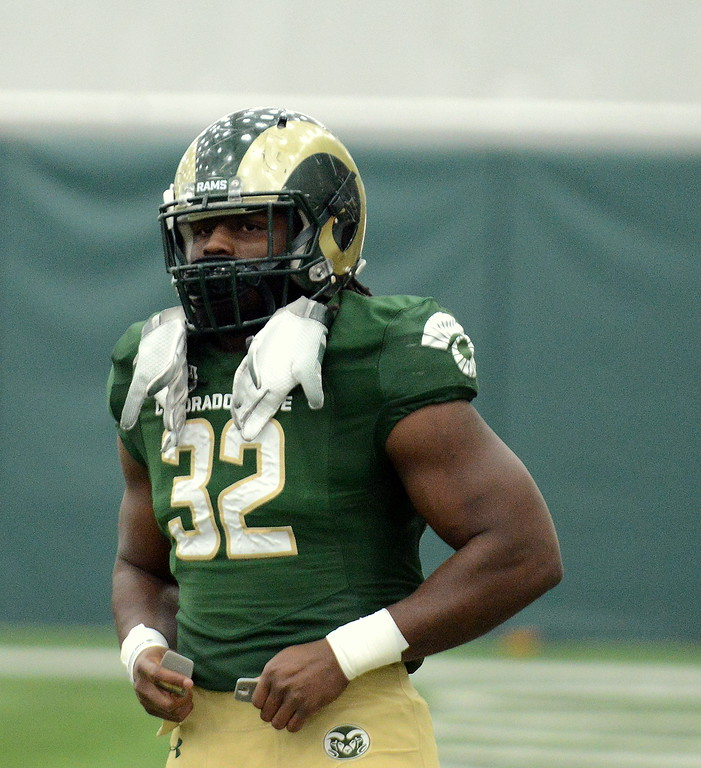 . Colorado State running back Marcus McElroy takes a breather before the start of Thursday\'s scimmage at the indoor practice facility. (Mike Brohard/Loveland Reporter-Herald)