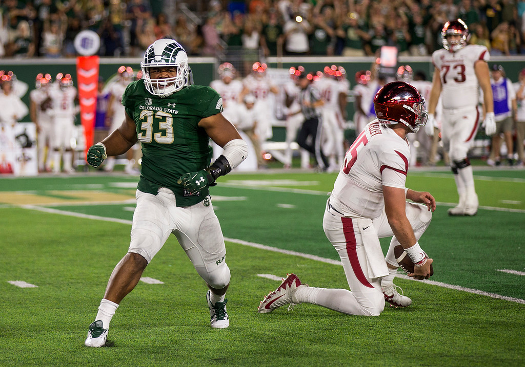 . Colorado State defensive end Emmanuel Jones (33) celebrates a quarterback sack against Arkansas Saturday evening Sept., 8, 2018 at Canvas Stadium in Fort Collins. The Rams beat the Razorbacks, 34-27. (Michael Brian/For the Reporter-Herald)
