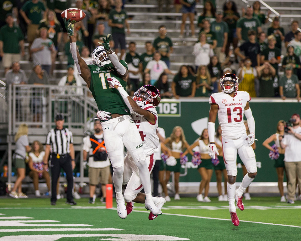 . Colorado State wide receiver Preston Williams (11) goes high for an end zone pass and tips the ball to himself against Arkansas Saturday evening Sept., 8, 2018 at Canvas Stadium in Fort Collins. The Rams beat the visiting Razorbacks, 34-27. (Michael Brian/For the Reporter-Herald)
