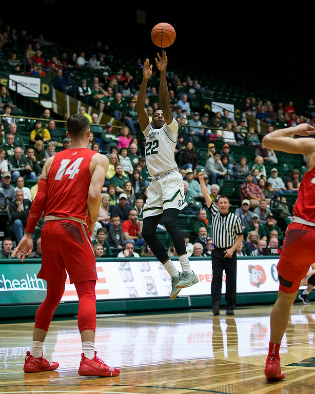 . Colorado State\'s J.D. Paige (22) rises up for a shot against New Mexico Saturday afternoon Jan., 12, 2018 at Moby Arena in Fort Collins. The Rams beat the Lobos 91-76. (Michael Brian/For the Reporter-Herald)