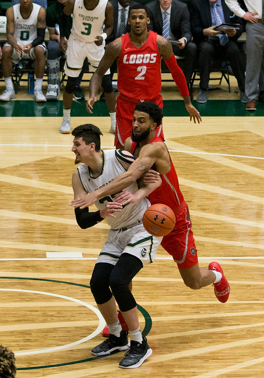 . Colorado State\'s Nicolas Carvacho (32) draws a foul against New Mexico Saturday afternoon Jan., 12, 2018 at Moby Arena in Fort Collins. The Rams beat the Lobos 91-76. (Michael Brian/For the Reporter-Herald)